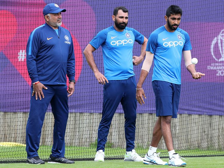 Mohammad Shami, centre, and Jasprit Bumrah