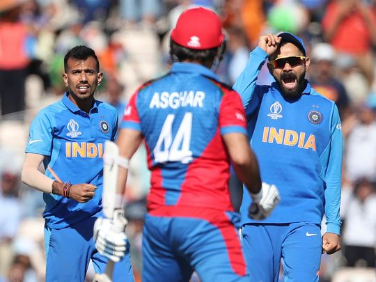 India's Yuzvendra Chahal, left, and captain Virat Kohli