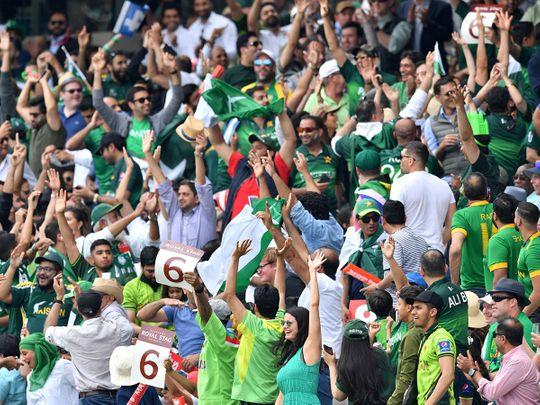 Spectators cheer after Pakistan's Haris Sohail hit a six