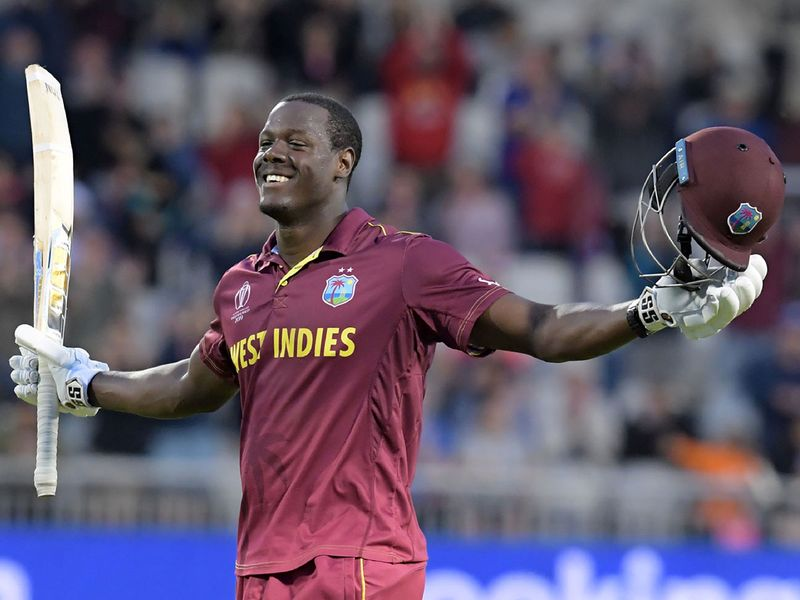 West Indies' Carlos Brathwaite celebrates reaching his century