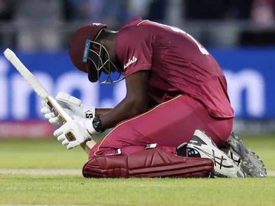 West Indies' Carlos Brathwaite reacts