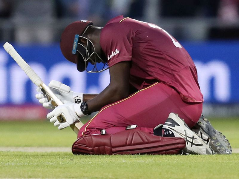 West Indies' Carlos Brathwaite reacts