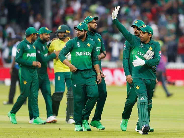 Pakistan's captain Sarfaraz Ahmed right waves