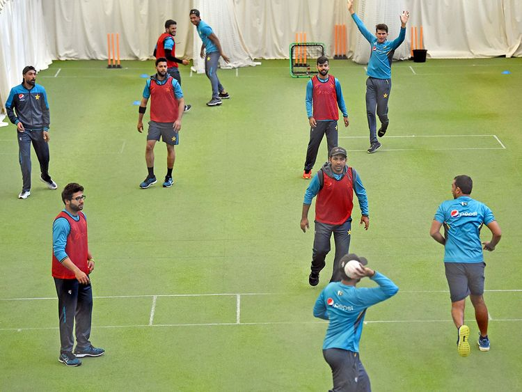 Pakistan players and support staff warm up