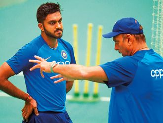 India's head coach Ravi Shastri (R) talks with Vijay Shankar