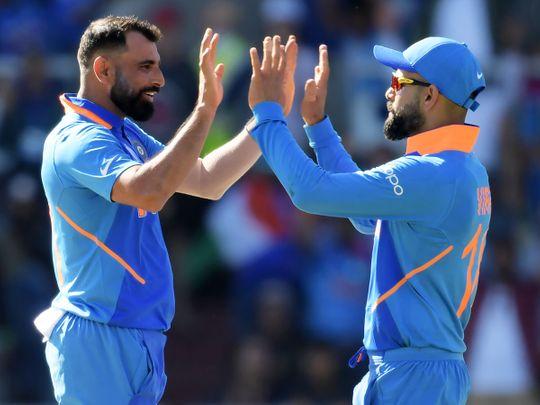 India's Mohammad Shami (left) celebrates with Virat Kohli