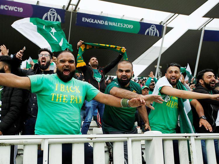 Pakistan fans cheer their team