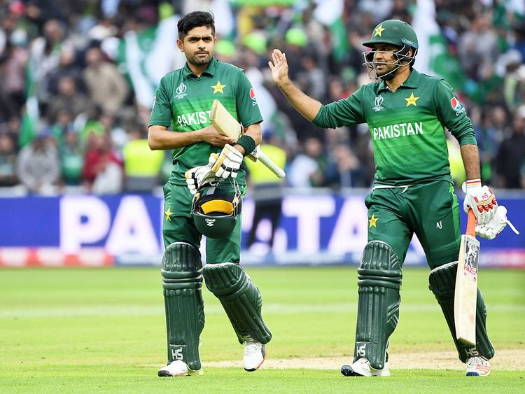 Pakistan's Babar Azam (L) and Sarfaraz Ahmad