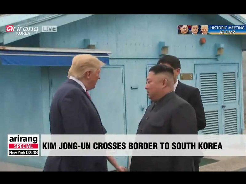 A screengab of the impromptu meeting between US President Donald Trump and North