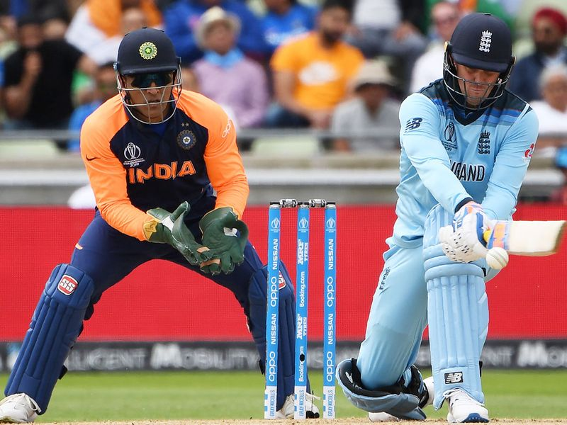 England's Jason Roy (R) attempts a reverse sweep shot