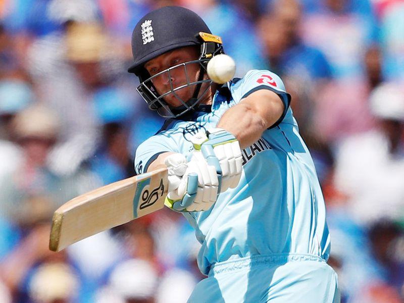 England's Jos Buttler hits a six