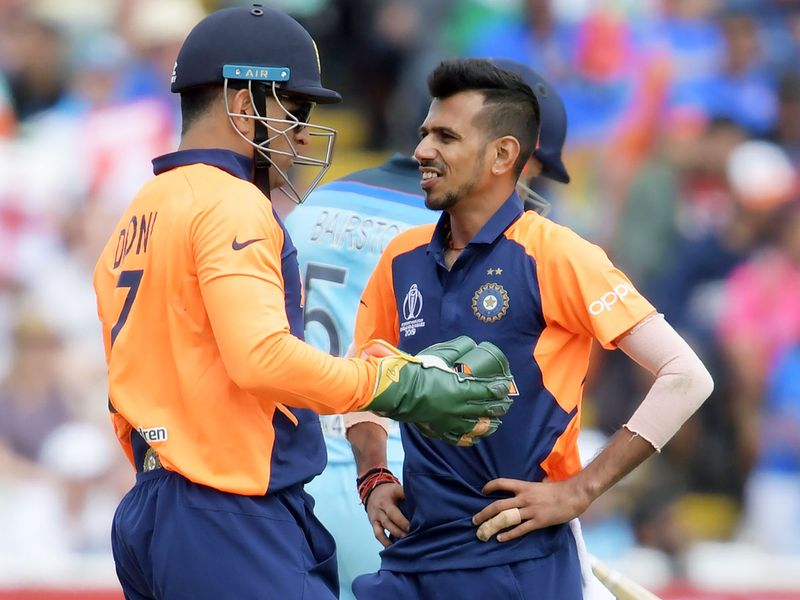 India's MS Dhoni (left) speaks with Yuzvendra Chahal