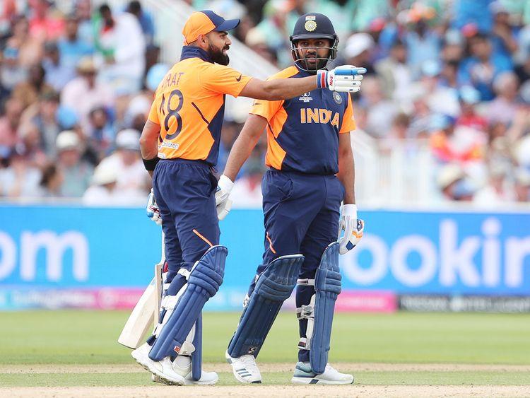 India's captain Virat Kohli, left, interacts with Rohit Sharma