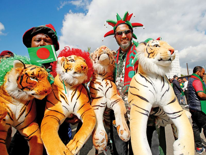 Bangladesh fans with toy tigers
