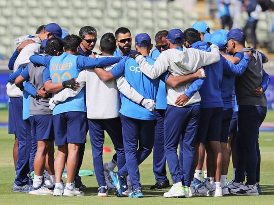 Indian players huddle together