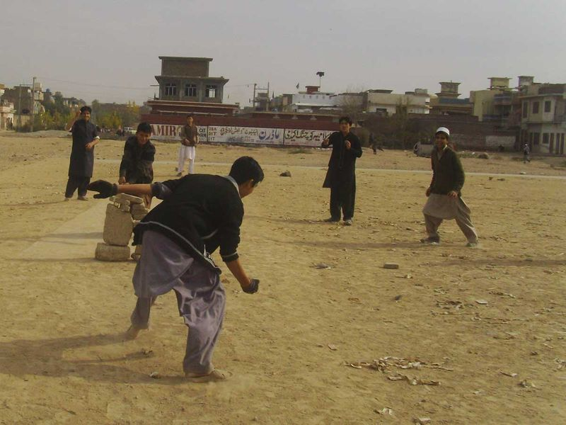 Children of Afghan refugees playing cricket