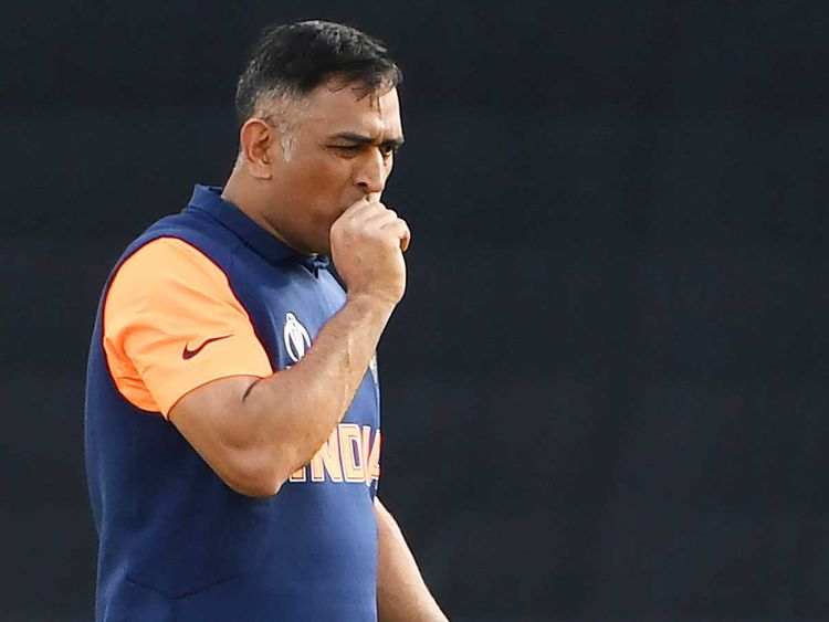 India's MS Dhoni reacts after being hit on the thumb