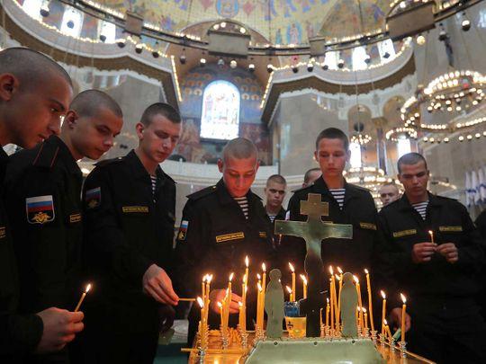 Russian servicemen attend a memorial service