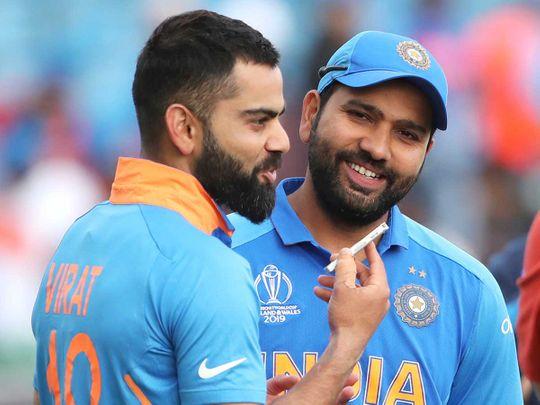 India's captain Virat Kohli, left, interviews teammate Rohit Sharma