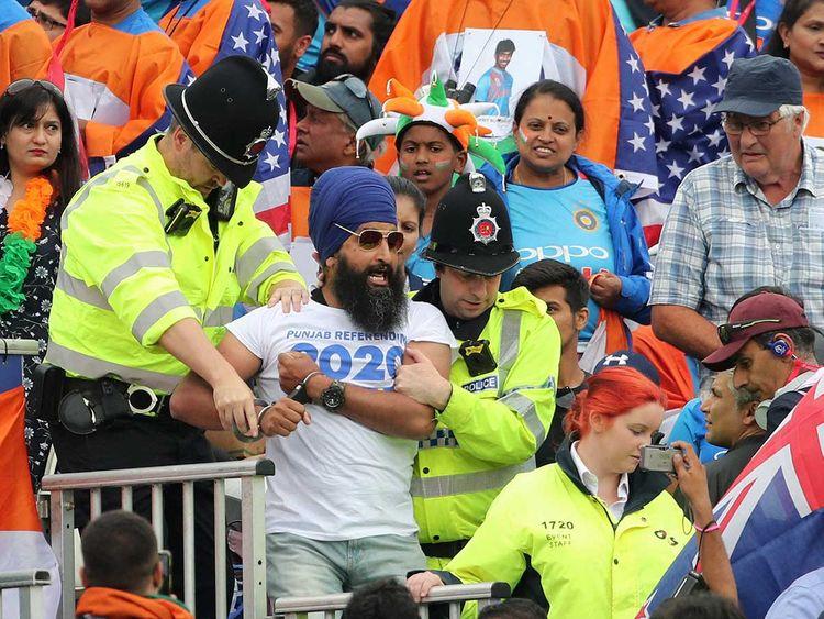 A handcuffed Sikh spectator
