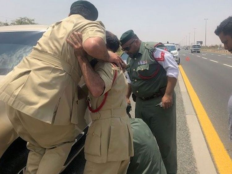 Dubai Police officers offer help