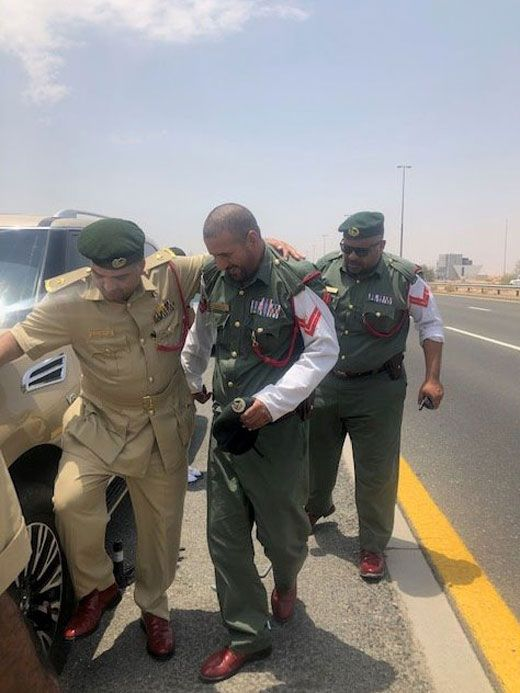 Dubai officers helping a motorist