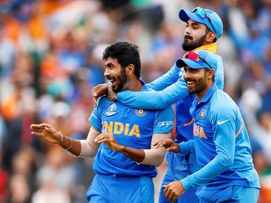 India's Jasprit Bumrah (left) celebrates