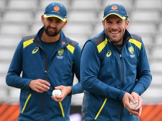 Australia's Nathan Lyon (L) and Aaron Finch