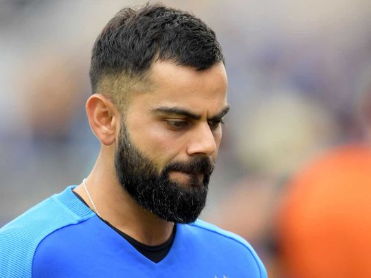India's captain Virat Kohli reacts