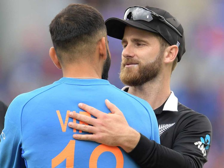 New Zealand's captain Kane Williamson (R) greets India's captain Virat Kohli