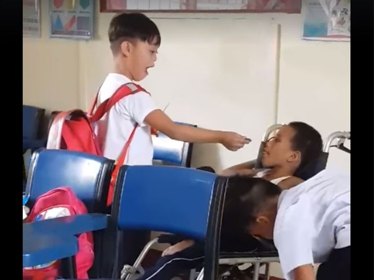 Special needs boys taking care of each other