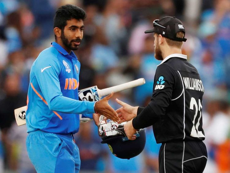 India's Jasprit Bumrah shakes hands with New Zealand's Kane Williamson