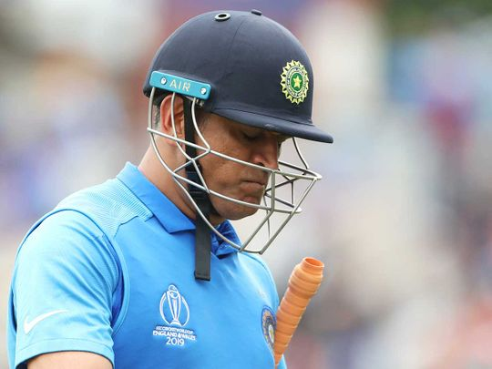 India's MS Dhoni reacts