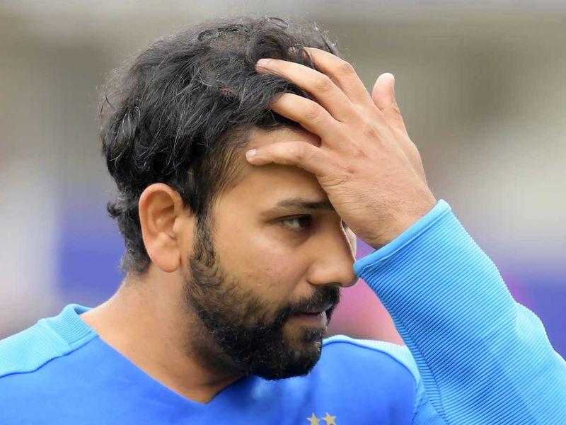 India's Rohit Sharma reacts