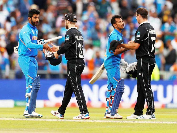 New Zealand players greet Indian batsmen Jasprit Bumrah