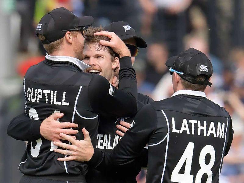 New Zealand's Lockie Ferguson (C) celebrates