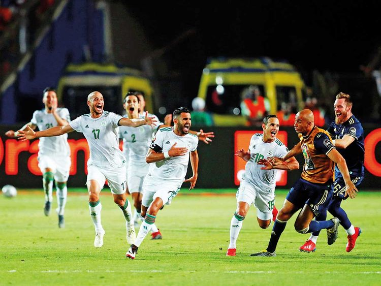 Algeria's Riyad Mahrez celebrates with teammates