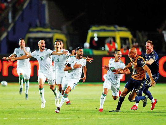 Algeria's Riyad Mahrez celebrates with teammates