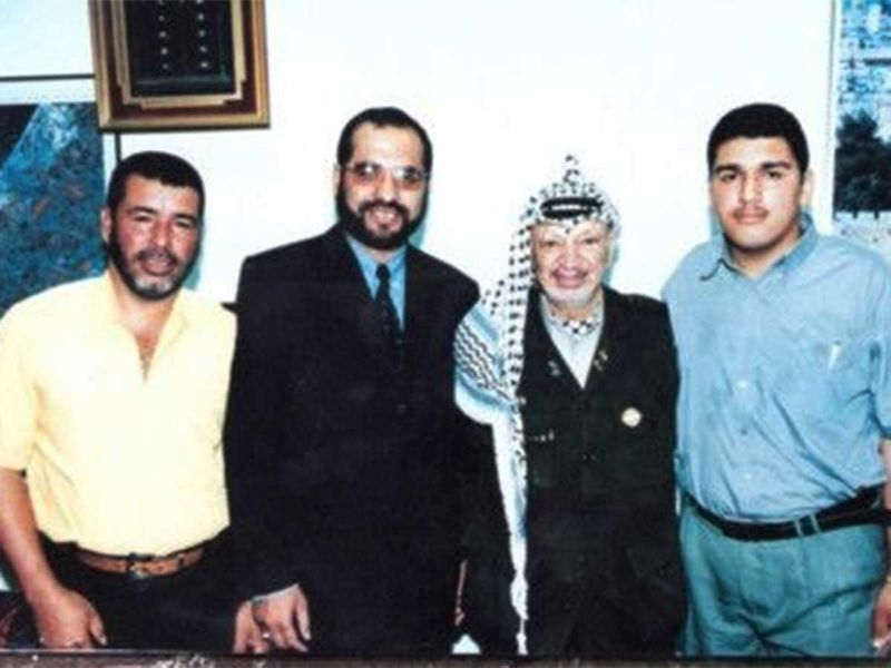 Mahmoud ElBurai (right) with Yasser Arafat (second from right)