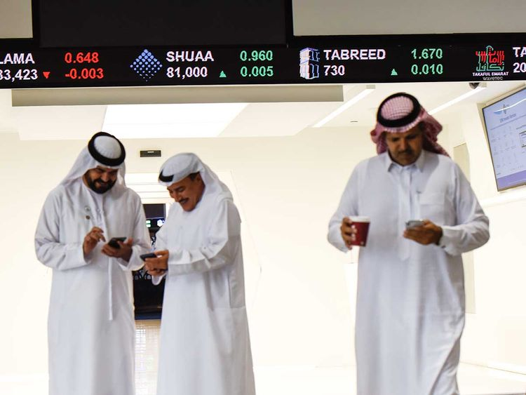 Traders at Dubai Financial Market (DFM).