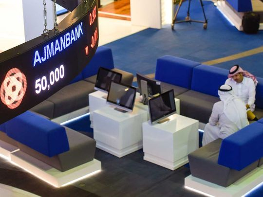 Traders at Dubai Financial Market (DFM)