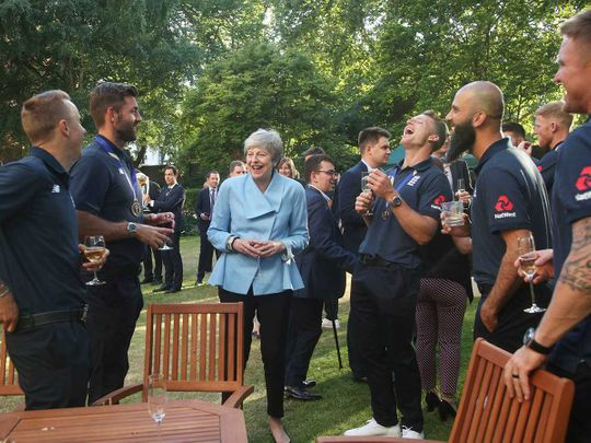 Britain's Prime Minister Theresa May with members of the England cricket team