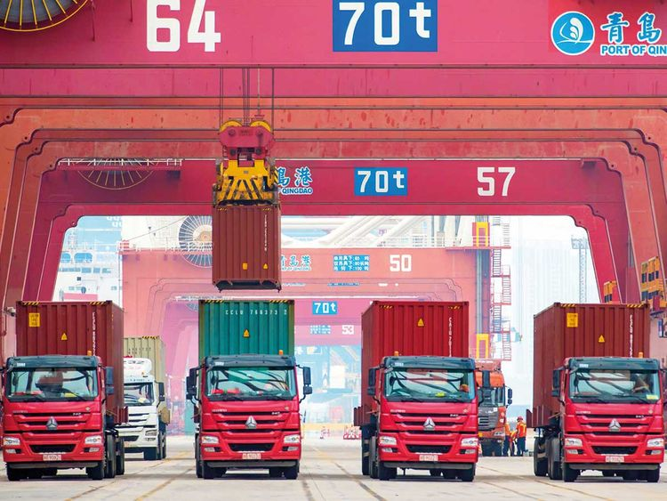 Trucks being loaded at the container port in Qingdao