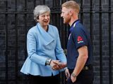 Britain's Prime Minister Theresa May shakes hands with England's Ben Stokes