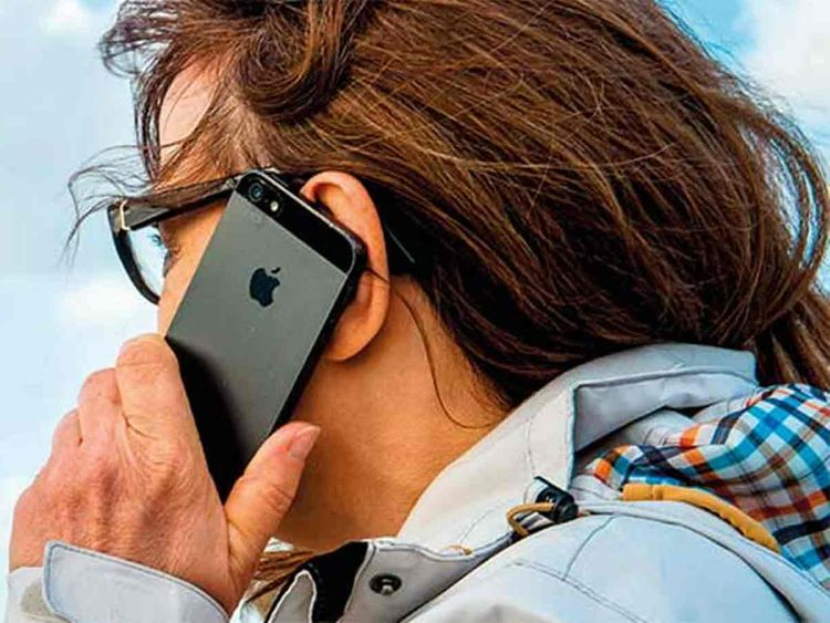 A woman uses her mobile phone