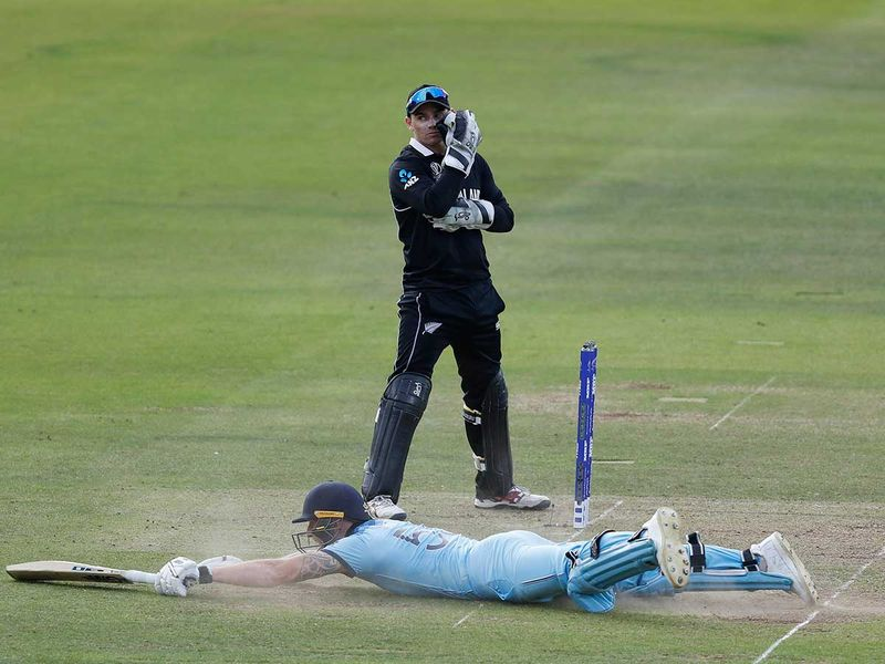 England's Ben Stokes dives in to make his ground