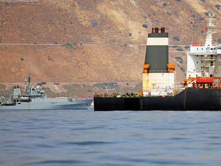 A British Royal Navy patrol vessel guards the Iranian oil tanker Grace 1