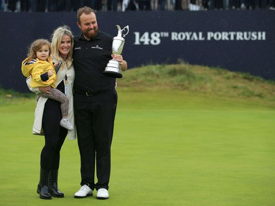 Ireland's Shane Lowry holds the Claret Jug trophy 0321