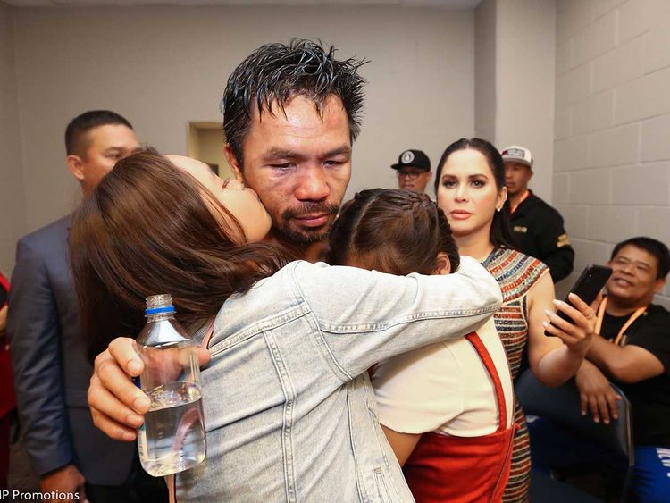 Manny Pacquiao (C) celebrating with members of his family