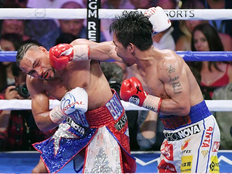 Manny Pacquiao (right) throws a right at Keith Thurman